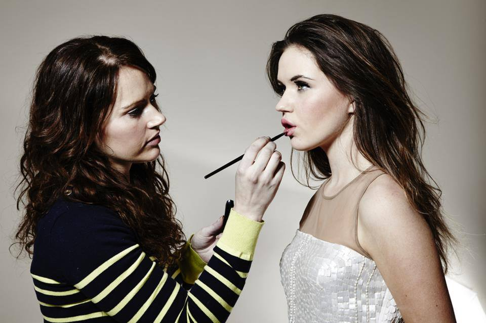 Hayley Sparkes applying makeup to a model